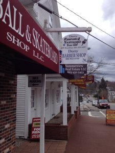custom awning and hanging storefront sign in Derry, NH